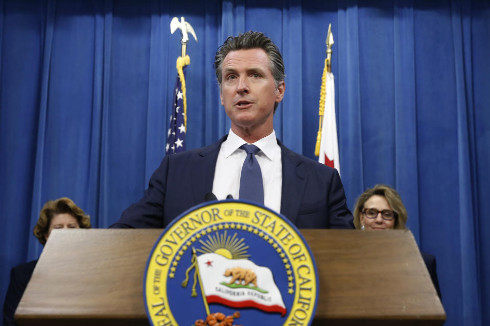FILE - In this July 23, 2019, file photo, California Gov. Gavin Newsom speaks at a news conference in Sacramento, Calif. The NCAA's Board of Governors is urging Gov. Gavin Newsom not to sign a California bill that would allow college athletes to receive money for their names, likenesses or images. In a six-paragraph letter to Newsom, the board said the bill would give California schools an unfair recruiting advantage. As a result, the letter says, the NCAA would declare those schools ineligible for its events. (AP Photo/Rich Pedroncelli, File)