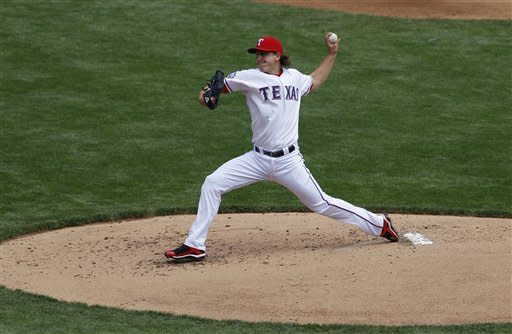Texas Rangers' Derek Holland delivers to the Seattle Mariners in the second inning of a baseball game Thursday, April 12, 2012, in Arlington, Texas. (AP Photo/Tony Gutierrez)