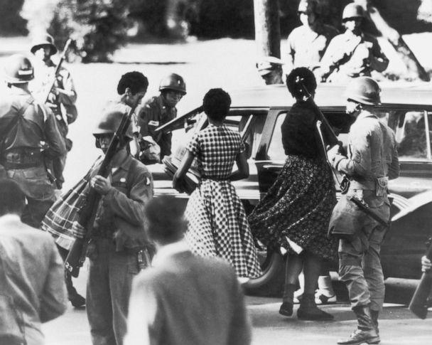 PHOTO: Black students are provided with a military escort when entering and leaving Little Rock Central High School, Ark., following the school's desegregation, 1957. (FPG/Hulton Archive via Getty Images, FILE)