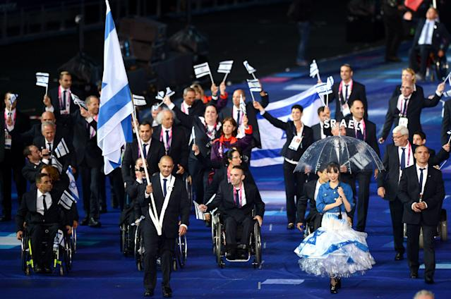 LONDON, ENGLAND - AUGUST 29: Shooter Doron Shaziri of Israel carry the flag during the Opening Ceremony of the London 2012 Paralympics at the Olympic Stadium on August 29, 2012 in London, England. (Photo by Gareth Copley/Getty Images)
