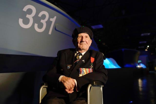 Second World War Coastal Forces veteran George Chandler, 96, who served as an Able Seaman on MTB 710, poses for a photograph in front of MTB 331 during a press preview for The Night Hunters: The Royal Navy's Coastal Forces at War exhibition at the Explosion Museum of Naval Firepower in Gosport, Hampshire