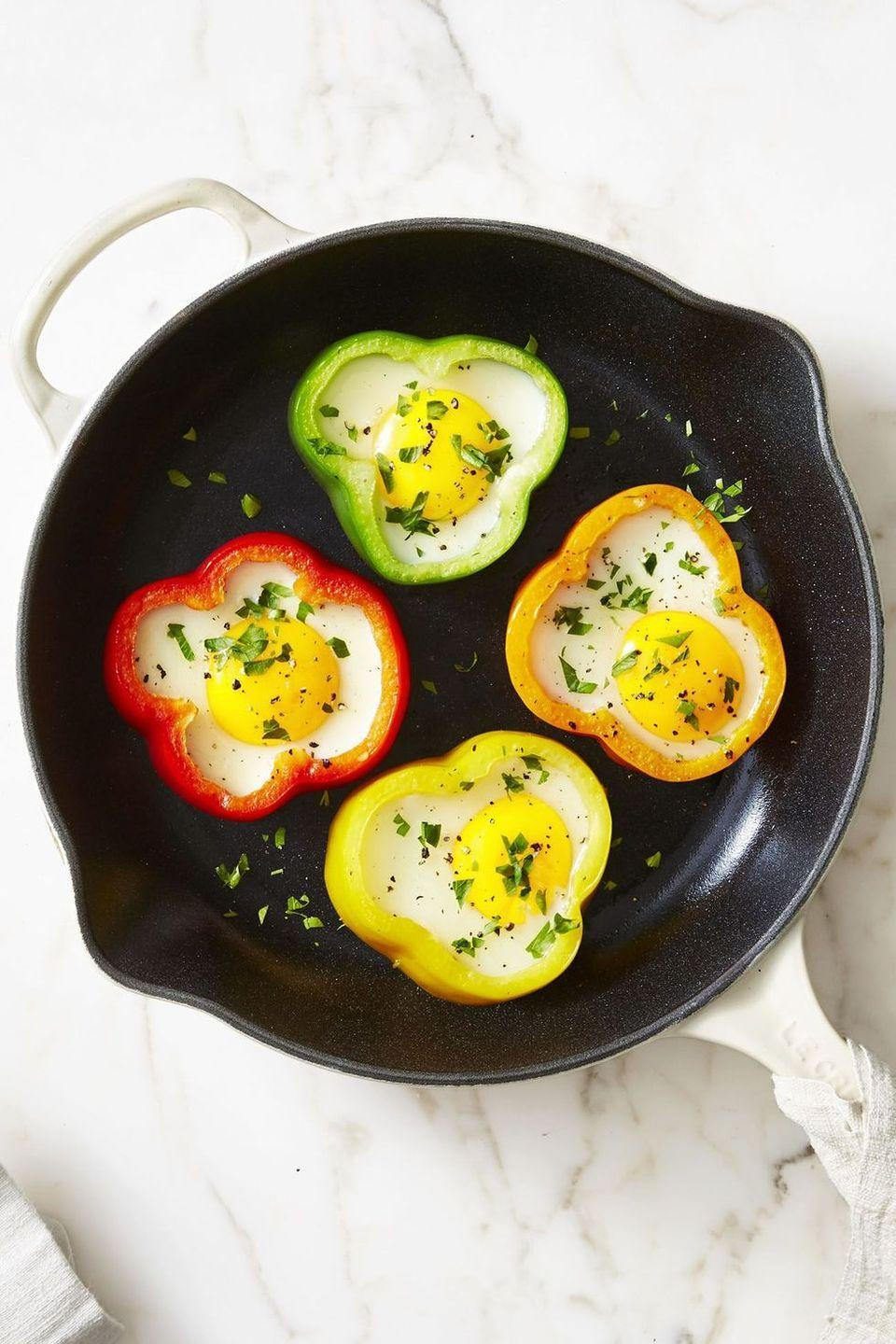 """<p>Think of this dish like eggs in a hole, but with more veggies.</p><p><em><a href=""""https://www.goodhousekeeping.com/food-recipes/a42847/flower-power-sunny-side-eggs-recipe/"""" rel=""""nofollow noopener"""" target=""""_blank"""" data-ylk=""""slk:Get the recipe for Flower Power Sunny-Side Eggs »"""" class=""""link rapid-noclick-resp"""">Get the recipe for Flower Power Sunny-Side Eggs »</a></em></p>"""