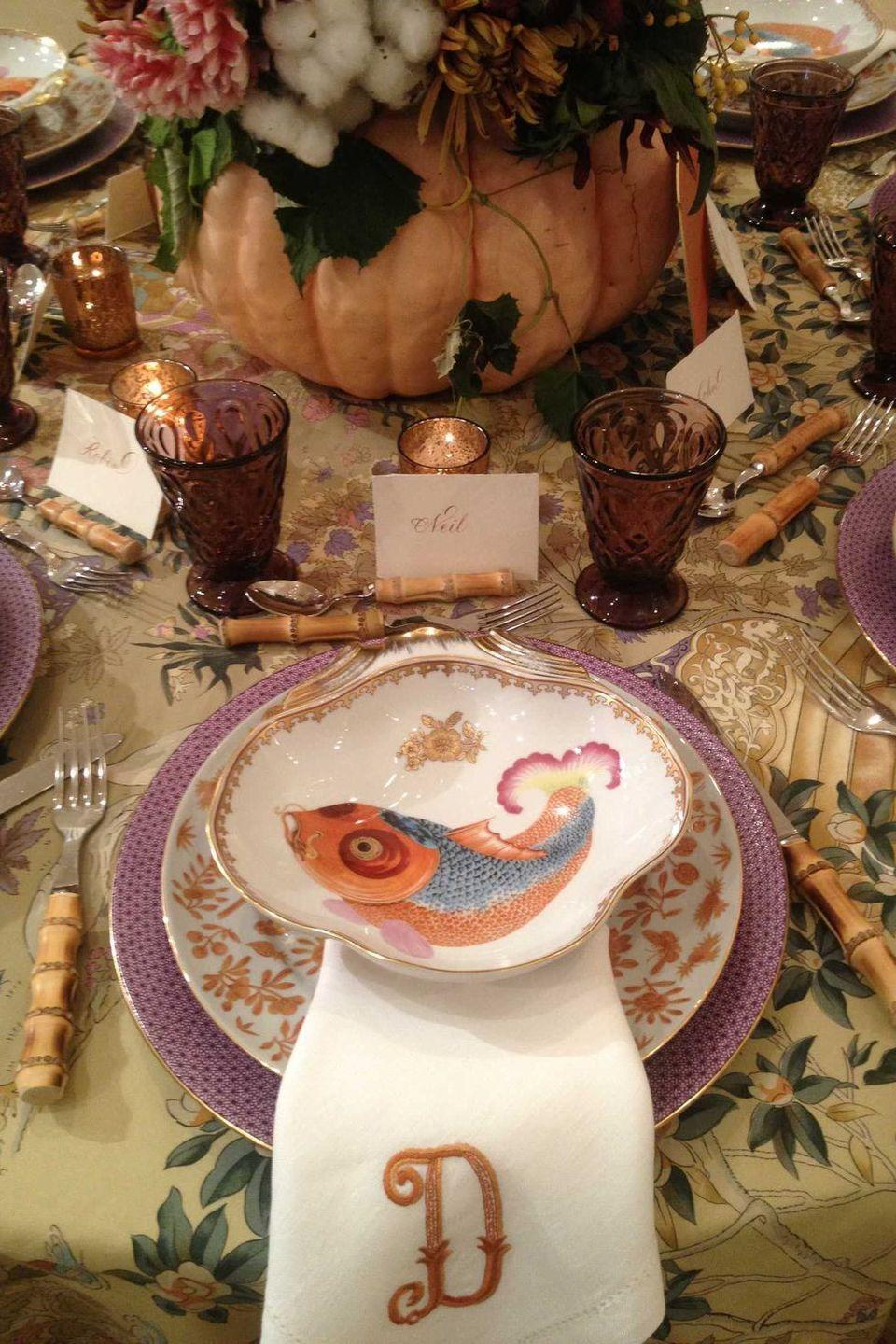 """<p>A tablecloth adorned in a floral motif is an easy way to add a sophisticated touch to a fall table arrangement. Add elegant place cards and monogrammed cloth napkins to make it feel even more special. Design by <a href=""""https://danielledrollins.com/"""" rel=""""nofollow noopener"""" target=""""_blank"""" data-ylk=""""slk:Danielle Rollins"""" class=""""link rapid-noclick-resp"""">Danielle Rollins</a>. </p>"""