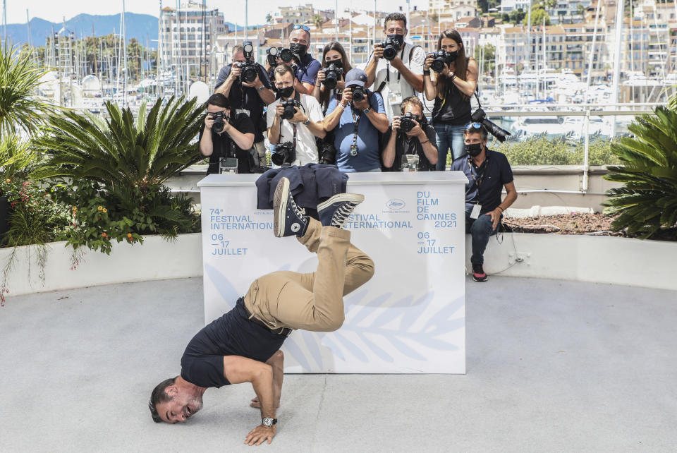 FILE - In this July 17, 2021 file photo Jean Dujardin poses for photographers at the photo call for the film 'OSS 117: From Africa with Love' at the 74th international film festival, Cannes, southern France. (Photo by Vianney Le Caer/Invision/AP, File)