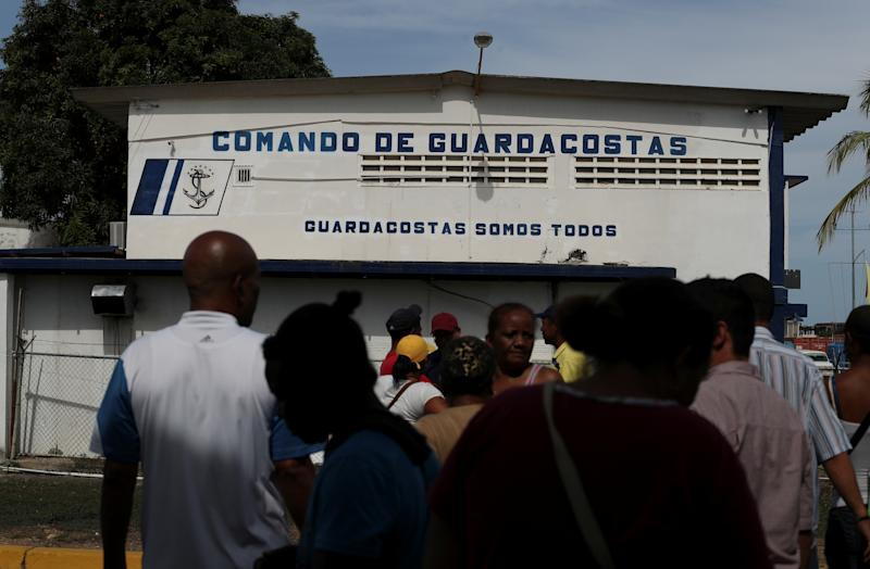 Relatives of the people who disappeared in the Caribbean Sea after boarding a smuggler's boat during an attempt to cross from Venezuela to Trinidad and Tobago, gather outside the coast guard building in Guiria, Venezuela, on May 23. (Photo: Ivan Alvarado/Reuters)