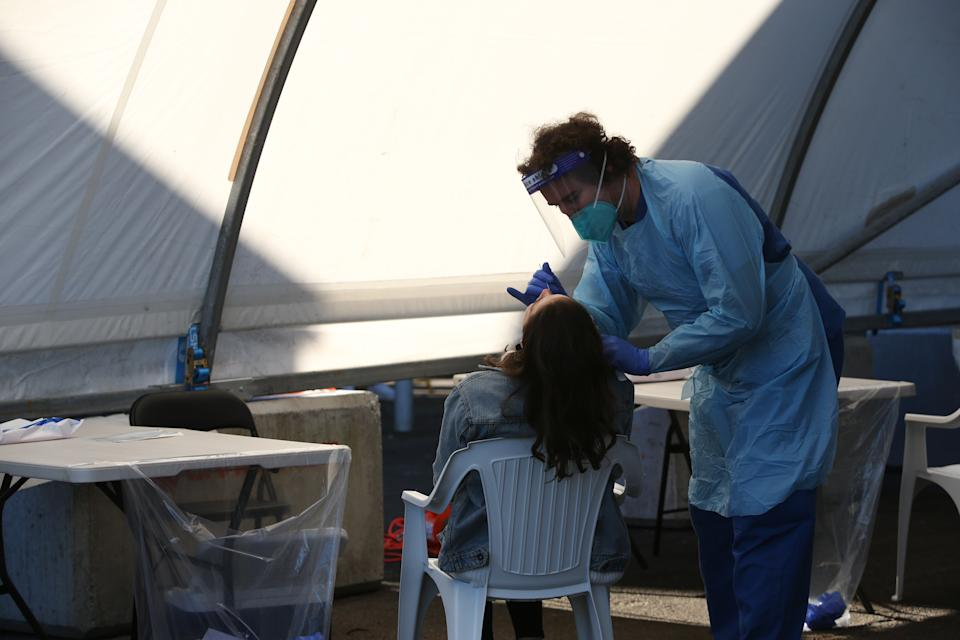 Emergency Nurse, conducts a COVID-19 swab test at the Rushcutters Bay mobile covid testing clinic on June 25, 2021 in Sydney, Australia.