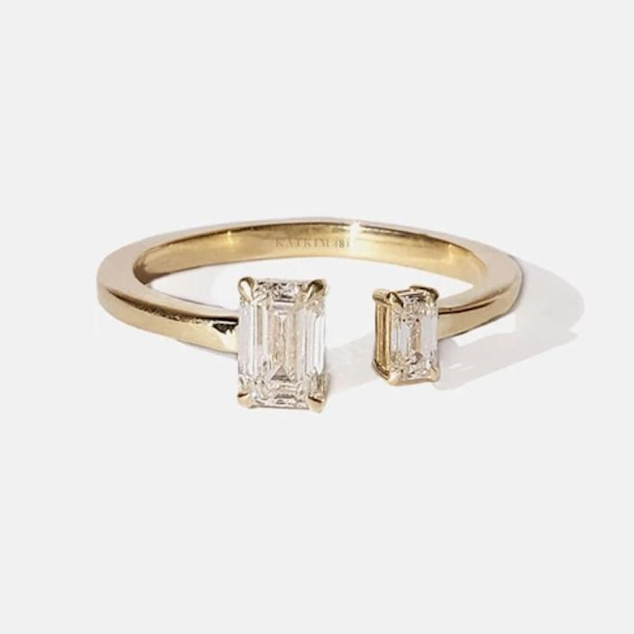 "$6800, Katkim. <a href=""https://katkimfinejewelry.com/collections/engagement-rings/products/mommy-me-emerald-diamond-ring"" rel=""nofollow noopener"" target=""_blank"" data-ylk=""slk:Get it now!"" class=""link rapid-noclick-resp"">Get it now!</a>"