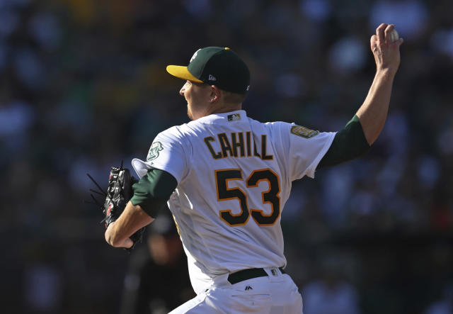 Oakland Athletics pitcher Trevor Cahill works against the San Francisco Giants during the first inning of a baseball game Saturday, July 21, 2018, in Oakland, Calif. (AP Photo/Ben Margot)