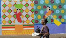Exhibits include large portraits and brightly painted murals