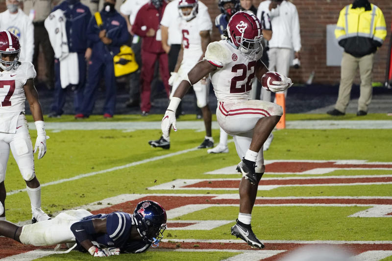 Alabama running back Najee Harris (22) dances after breaking a Mississippi tackle and scoring a touchdown during the first half of an NCAA college football game in Oxford, Miss., Saturday, Oct. 10, 2020. (AP Photo/Rogelio V. Solis)