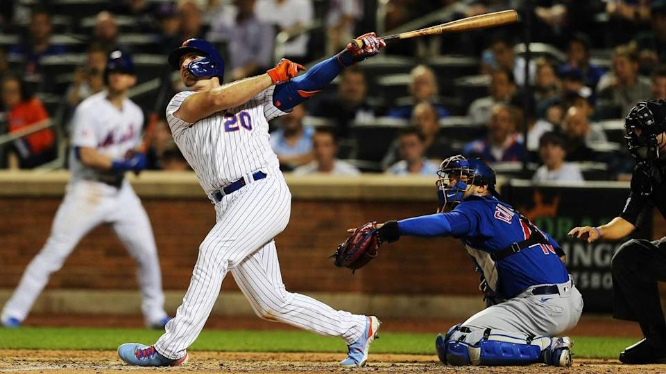 Pete Alonso follows through on sac fly against Cubs at Citi Field June 2021 full body