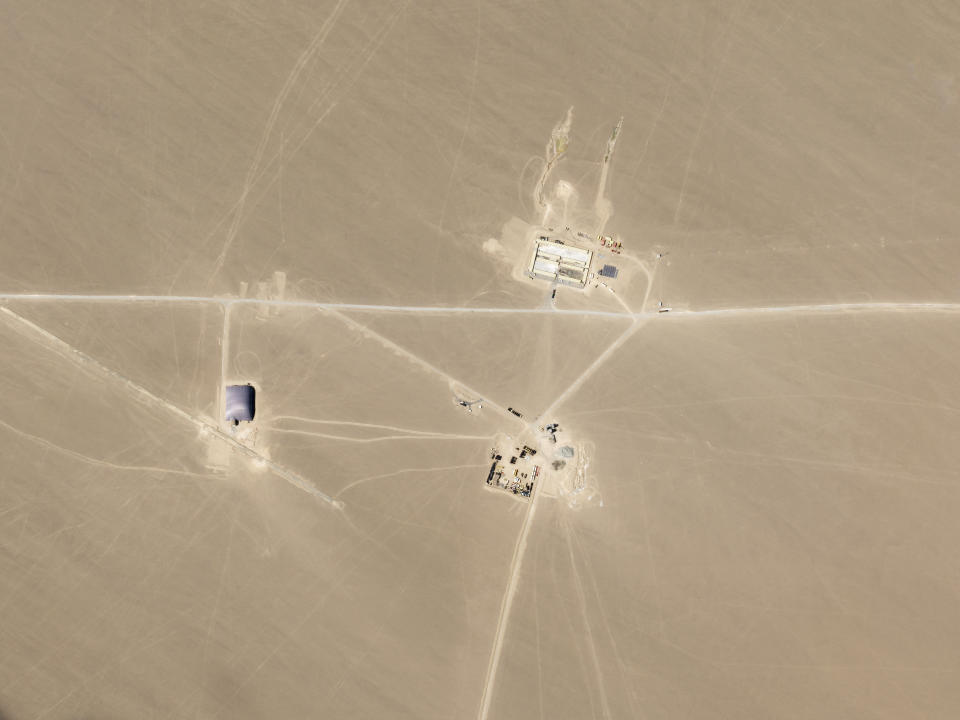 This July 25, 2021, satellite image provided by Planet Labs Inc. shows what analysts believe is construction on an intercontinental ballistic missile silo near Hami, China. The U.S. military is warning about what analysts have described as a major expansion of China's nuclear missile silo fields, at a time of heightened tension between the U.S. and China. (Planet Labs Inc. via AP)