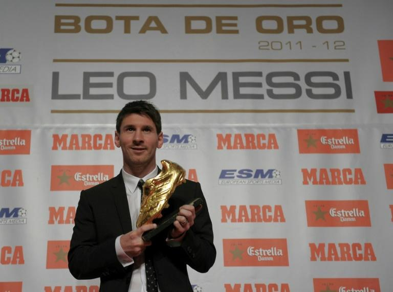 Lionel Messi poses with the European Golden Boot after scoring 50 Spanish league goals for Barcelona in 2011/12