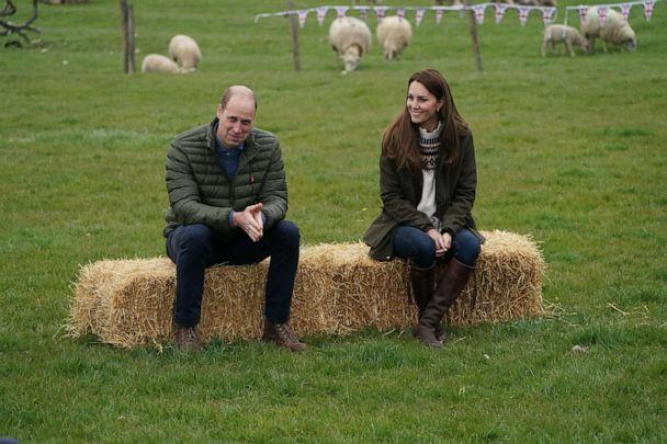 PHOTO: Prince William, Duke of Cambridge, and Catherine, Duchess of Cambridge, react during a visit to Manor Farm in Little Stainton, near Durham, England, on April 27, 2021. (Owen Humphreys/Pool/AFP via Getty Images)