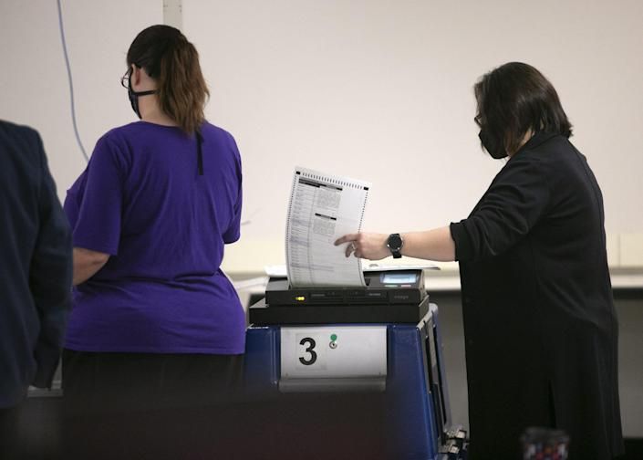 A Maricopa County election employee works during a postelection logic and accuracy test with the tabulation machines at the Maricopa County elections tabulation center in Phoenix on Nov. 18, 2020. The Maricopa County Elections Department runs a logic and accuracy test with a number of sample ballots before and after every election.