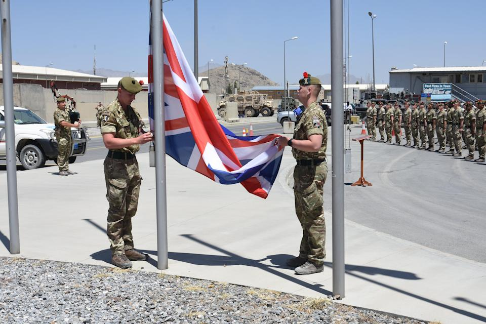 Brigadier Oliver Brown, General Miller and the UK Ambassador attended a flag lowering ceremony in Afghanistan (UK Ministry of Defence via Getty)