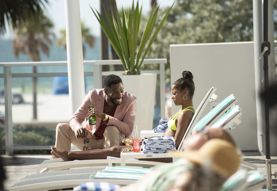 """This image released by A24 shows Colman Domingo, left, and Taylour Paige in a scene from """"Zola."""" (Anna Kooris/A24 Films via AP)"""
