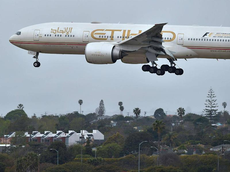 An Etihad Airways aircraft, flight 171 from Abu Dhabi, comes in for a landing at LA International Airport (Getty)