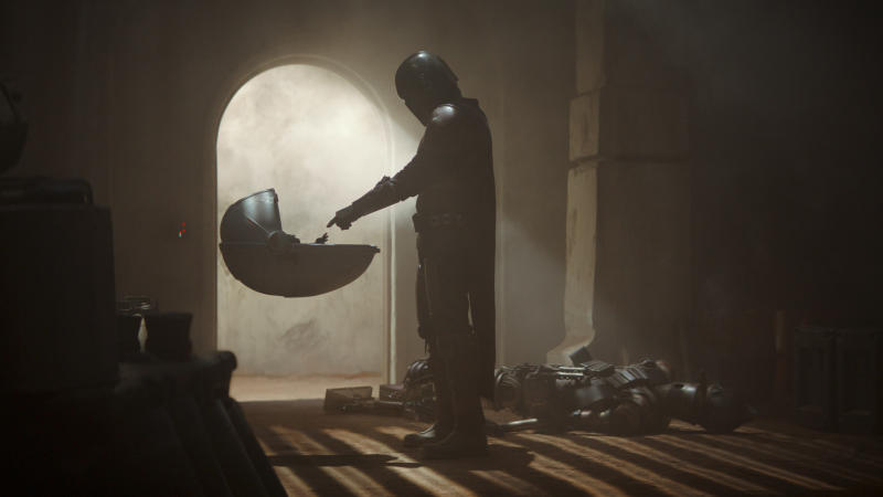 The Child meets the title character in 'The Mandalorian'. (Credit: Disney+)