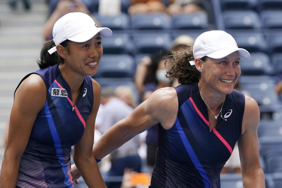 Shual Zhang, of China, left, and Samatha Stosur, of Australia, celebrate after defeating Coco Gauff and Catherine McNally, both of the United States, during the women's doubles final at the US Open tennis championships, Sunday, Sept. 12, 2021, in New York. (AP Photo/Elise Amendola)