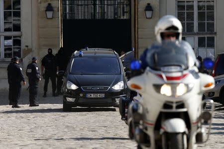 Police officers escort vehicles thought to be transporting Nemmouche, the French national who is suspected of the shooting attack in the Brussels Jewish Museum last month, as he leaves after an extradition hearing at the Appeal Court of Versailles