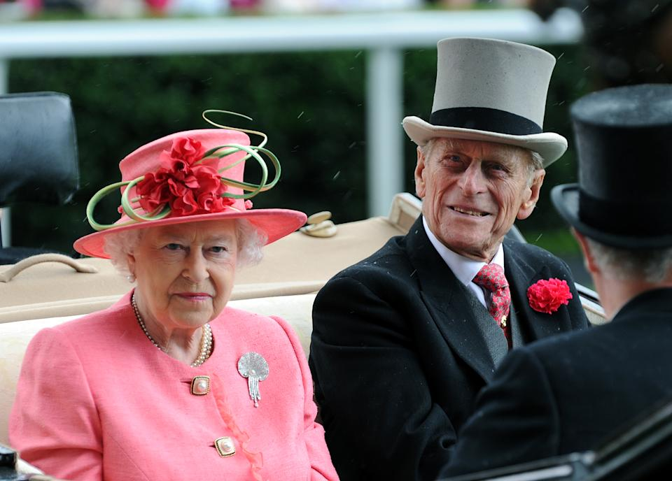 ASCOT, UNITED KINGDOM - JUNE  16:  Queen Elizabeth ll and Prince Philip, Duke of Edinburgh arrive in an open carriage on Ladies Day at Royal Ascot on June 16, 2011 in Ascot, United Kingdom.    (Photo by Anwar Hussein/WireImage)