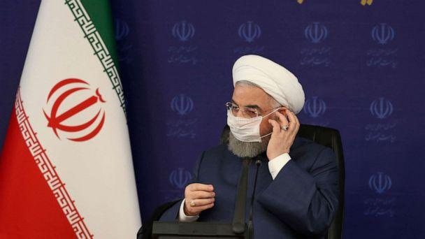 PHOTO: In this photo released by the official website of the office of the Iranian Presidency, President Hassan Rouhani adjusts his face mask in a meeting of the national headquarters of the fight against the COVID-19, in Tehran, Iran, July 18, 2020. (Iranian Presidency Office via AP)