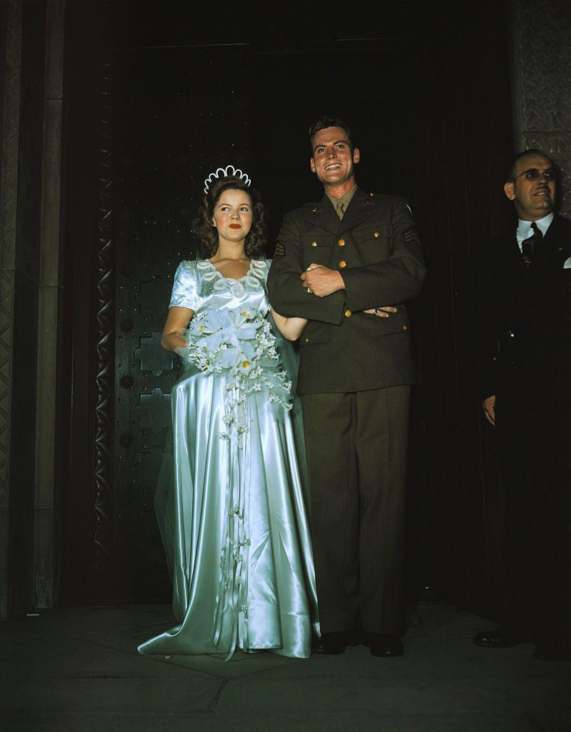 <p>When former child star Shirley Temple married Army Corps sergeant, John Agar, in 1945, it was an event that all of America wanted to witness. Her dress, a full-length stain gown with short sleeves, was on par with the fashion of the time, but the unusual beaded neckline and matching headpiece were far from typical. </p>