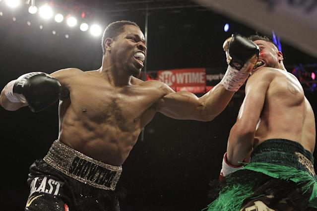 Shawn Porter, left, fights Paulie Malignaggi during the second round of their IBF Welterweight Champioship boxing match, Saturday, April 19, 2014, in Washington. Porter won with a TKO in the fourth round. (AP Photo/Luis M. Alvarez)
