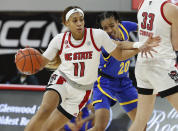 North Carolina State's Jakia Brown-Turner (11) drives around Pittsburgh's Jayla Everett (20) during the first half of an NCAA college basketball game, Thursday, Feb. 25, 2021 in Raleigh, N.C. (Ethan Hyman/The News & Observer via AP, Pool)