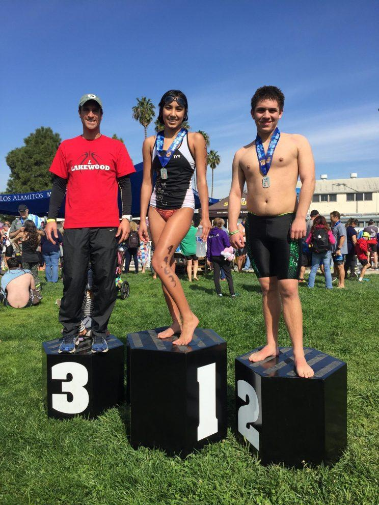 Lakewood High School coach David Klein (L) poses on the podium with his athletes Jordan Chalmers (C) and Aaron Martinez (R). (David Klein)