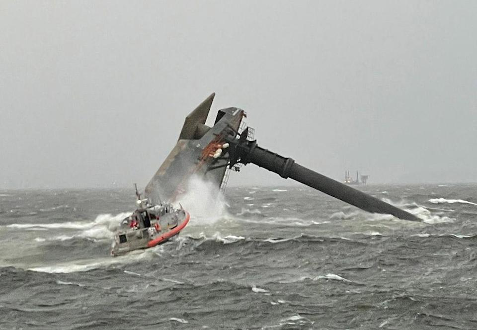 Image: A Coast Guard Station Grand Isle boat crew heading toward a capsized 175-foot commercial lift boat April 13, 2021 searching for people in the water 8 miles south of Grand Isle, La. (US Coast Guard / AFP - Getty Images)