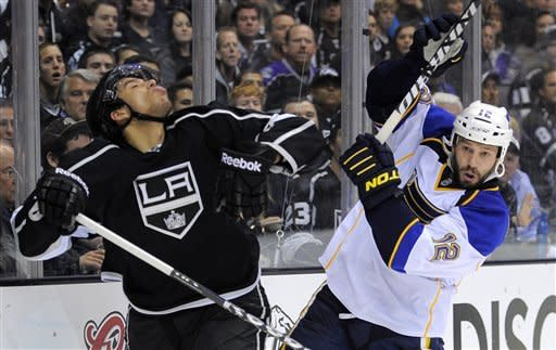 Los Angeles Kings center Jordan Nolan, left, reacts after he was hit on the face by the stick of St. Louis Blues center Scott Nichol during the third period in Game 4 of an NHL hockey Stanley Cup second-round playoff series, Sunday, May 6, 2012, in Los Angeles. Nichol received a four-minute double minor on the play. The Kings won 3-1 to win the series 4-0. (AP Photo/Mark J. Terrill)