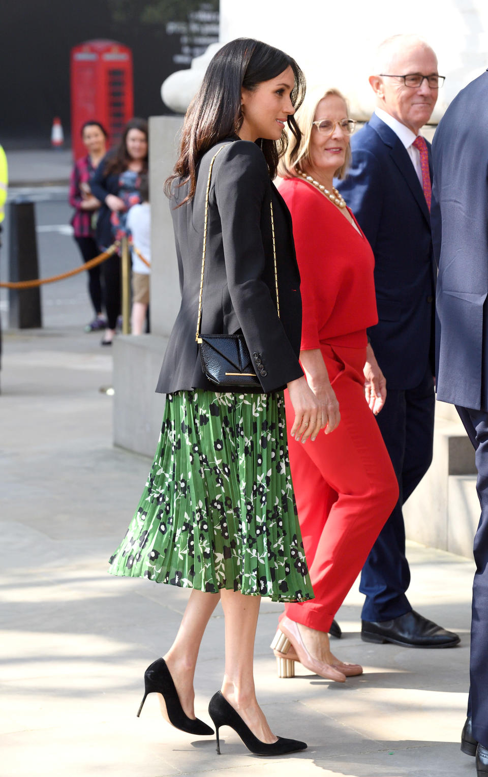 <p>She paired the dress with some other fashion favourites: a chic $2,000 Alexander McQueen blazer, a Roland Mouret crossbody bank and Manolo Blahnik suede pumps. </p>