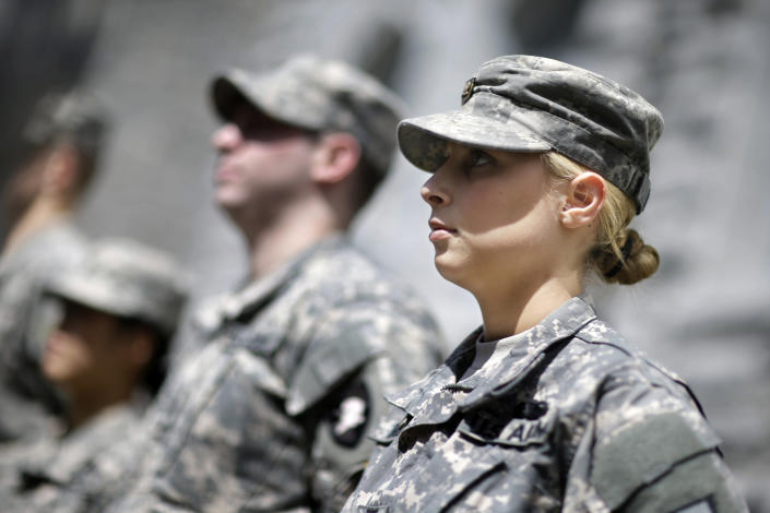 In this April 9, 2014 photo, West Point cadet Austen Boroff, right, of Chatham, N.J., stands in formation with others, as she waits to march to lunch at the United States Military Academy in West Point, N.Y. With the Pentagon lifting restrictions for women in combat jobs, Lt. Gen. Robert Caslen Jr. has set a goal of boosting the number of women above 20 percent for the new class reporting this summer. (AP Photo/Mel Evans)