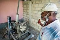 Lucien Jean-Francois, principal of the public Tabarre school in Port-au-Prince, shows the school's generator; a part was stolen, so water can only be pumped by hand at a time when frequent washing is being urged to stem the coronavirus's spread