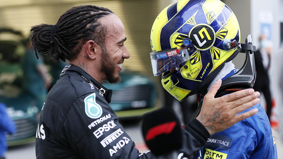 Lewis Hamilton consoled a devastated Lando Norris after the McLaren driver claimed an almost certain victory with less than five laps to go in the Russian GP.  (Photo by Yuri Kochetkov - Pool / Getty Images)