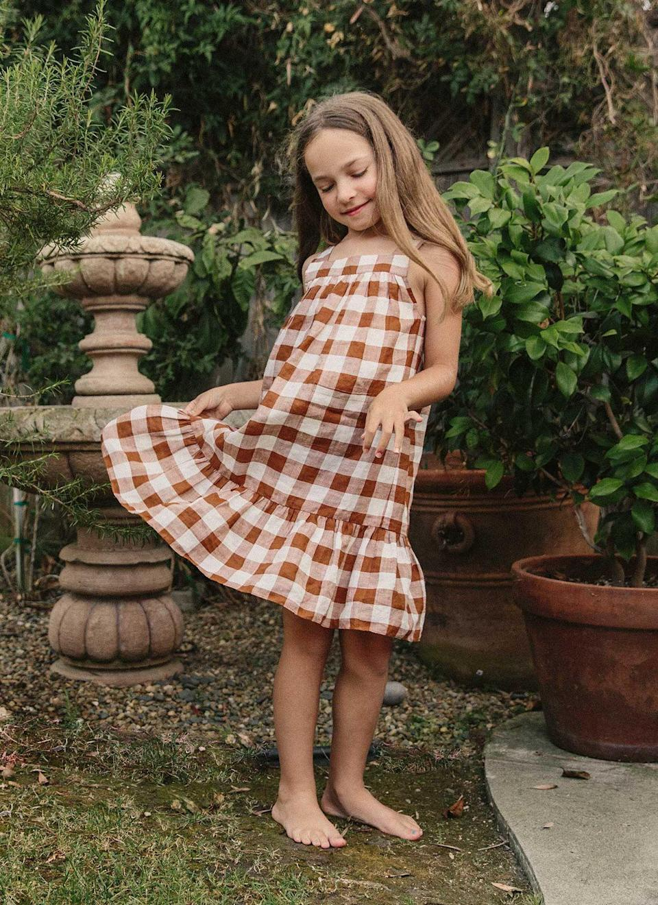 "<p>heathertaylorhome.com</p><p><strong>$94.00</strong></p><p><a href=""https://heathertaylorhome.com/shop/hth-x-doen-gingham-nutmeg-little-eve-dress/"" rel=""nofollow noopener"" target=""_blank"" data-ylk=""slk:Shop Now"" class=""link rapid-noclick-resp"">Shop Now</a></p>"