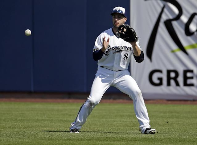 Milwaukee Brewers' Ryan Braun catches a ball during an exhibition spring training baseball game against the San Diego Padres Friday, March 7, 2014, in Phoenix. (AP Photo/Morry Gash)