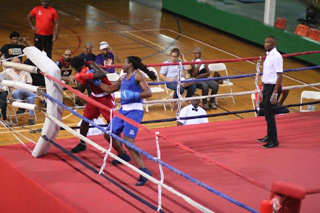 Cam F. Awesome (R) punches Joseph Beckles during their heavyweight fight on Nov. 3, 2019 at the Jean Pierre Complex in Port of Spain, Trinidad. (Photo courtesy of Cam F. Awesome)