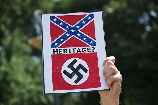 A sign equates the Confederate flag with the Nazi flag at a protest in Columbia, South Carolina, on June 23, 2015.