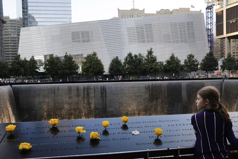 FILE - Charlotte Newman, 8, visits the National September 11 Memorial and Museum, Sunday, Sept. 8, 2013 in New York. The long-awaited museum dedicated to the victims of the Sept. 11 terror attacks will open to the public at the World Trade Center site on May 21, officials announced Monday, March 24, 2014. (AP Photo/Mark Lennihan, File)