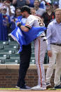 Chicago Cubs owner Tom Ricketts, left, embraces San Francisco Giants' Kris Bryant before a baseball game in Chicago, Friday, Sept. 10, 2021. (AP Photo/Nam Y. Huh)
