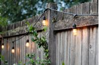 <p>Any outdoor gathering would be so much more fun if classic string lights are in the mix, whether you choose to hang them on a fence or under a pergola.</p>