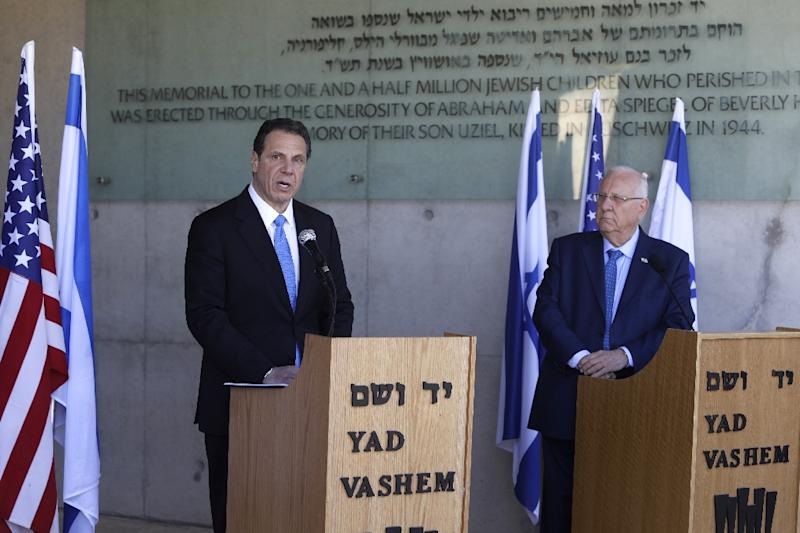 The Governor of New York Andrew Cuomo (L) speaks as he stand next to Israeli President Reuven Rivlin on March 5, 2017, during his visit to the Yad Vashem Holocaust Memorial museum in Jerusalem
