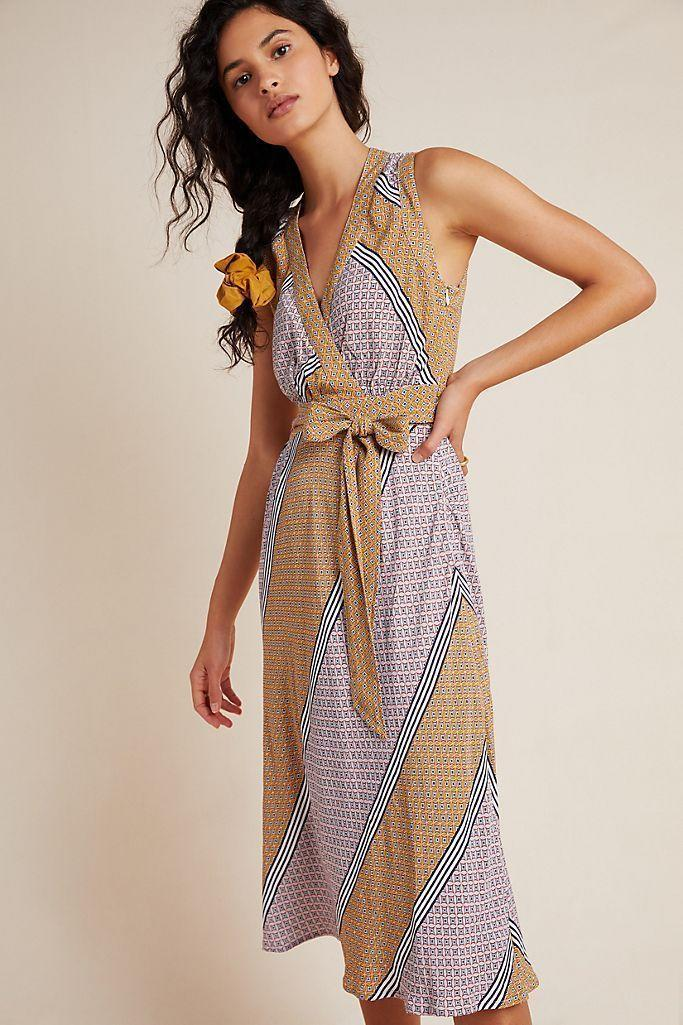 """<p><strong>Anthropologie </strong></p><p>www.anthropologie.com</p><p><strong>$118.00</strong></p><p><a href=""""https://go.redirectingat.com?id=74968X1596630&url=https%3A%2F%2Fwww.anthropologie.com%2Fshop%2Fcarla-wrap-dress%3Fcategory%3DSEARCHRESULTS%26color%3D266%26searchparams%3Dq%253Dwrap%252520dress%26type%3DSTANDARD%26quantity%3D1&sref=https%3A%2F%2Fwww.marieclaire.com%2Ffashion%2Fg32662286%2Faffordable-sundresses%2F"""" rel=""""nofollow noopener"""" target=""""_blank"""" data-ylk=""""slk:Shop Now"""" class=""""link rapid-noclick-resp"""">Shop Now</a></p><p>This wrap dress has a tailored feel that is perfect for any weekend activity. Keep it simple with a pair of <a href=""""https://www.shopbop.com/triple-kick-leather-sneakers-keds/vp/v=1/1550973135.htm?fm=search-viewall-shopbysize&os=false&ref_=SB_PLP_NB_9"""" rel=""""nofollow noopener"""" target=""""_blank"""" data-ylk=""""slk:white sneakers"""" class=""""link rapid-noclick-resp"""">white sneakers</a>, you'll be cute and comfy all weekend long.</p>"""