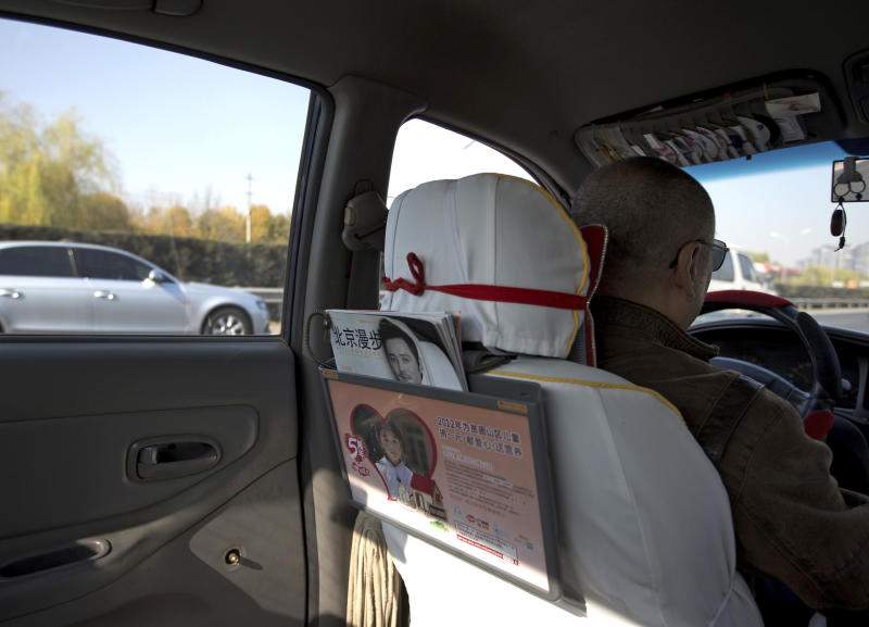 A window handle on the door at the back seat is seen removed in a taxi in Beijing Thursday, Nov. 1, 2012. Beijing is tightening security as its all-important Communist Party congress approaches, and some of the measures seem bizarre. Not only have taxi drivers removed the window handles from their doors, but their passengers must sign agreements promising to keep their windows and doors locked. Most of the security measures were implemented in time for Thursday's opening of a meeting of the Central Committee. (AP Photo/Andy Wong)