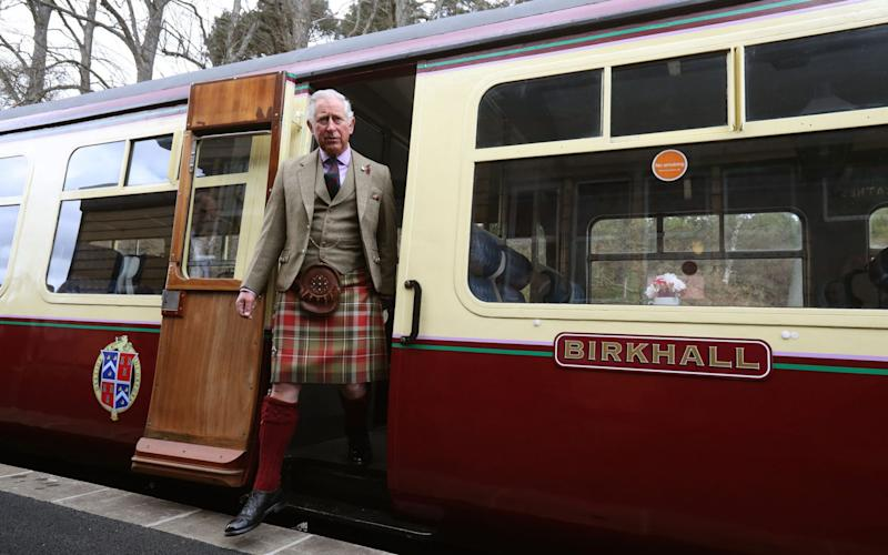 Prince Charles tours a carriage that was partly restored with his donation - Credit: Andrew Milligan/PA