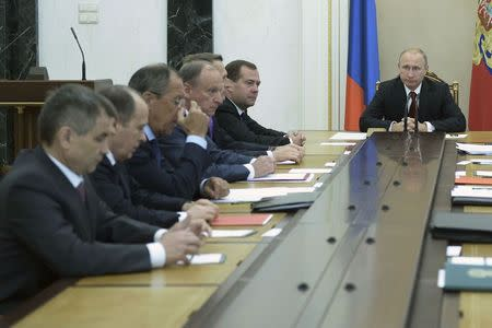 Russian President Vladimir Putin chairs a meeting of the Security Council at the Kremlin in Moscow