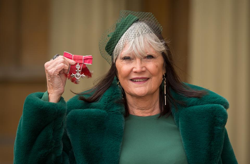 LONDON, UNITED KINGDOM - FEBRUARY 8:  Singer Sandie Shaw poses with her MBE medal, following an investiture ceremony at Buckingham Palace on February 8, 2018 in London, England. (Photo by Dominic Lipinski - WPA Pool/Getty Images)